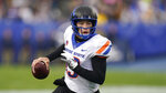 Boise State quarterback Hank Bachmeier (19) carries the ball against BYU in the first half during an NCAA college football game Saturday, Oct. 9, 2021, in Provo, Utah. (AP Photo/Rick Bowmer)