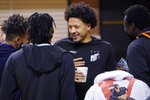 Cade Cunningham, center, talks with his teammates after announcing that he will enter the NBA draft after a dynamic freshman season that saw him named a first-team AP All-American, Thursday, April 1, 2021, in Stillwater, Okla. (AP Photo/Sue Ogrocki)