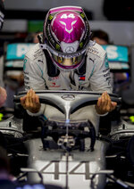 Mercedes driver Lewis Hamilton of Britain gets out of his car in the pit garage during the Formula One pre-season testing session at the Barcelona Catalunya racetrack in Montmelo, outside Barcelona, Spain, Wednesday, Feb. 26, 2020. (AP Photo/Joan Monfort)