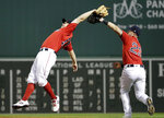 Boston Red Sox second baseman Brock Holt, left, leans back to catch a pop fly by Tampa Bay Rays' Avisail Garcia during the eighth inning of a baseball game at Fenway Park, Friday, June 7, 2019, in Boston. At right is first baseman Michael Chavis. (AP Photo/Elise Amendola)