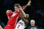 Wisconsin forward Nate Reuvers (35) gets tangled up with Richmond forward Souleymane Koureissi (2) during the second half of an NCAA college basketball game in the Legends Classic, Monday, Nov. 25, 2019, in New York. Richmond defeated Wisconsin 62-52. (AP Photo/Kathy Willens)