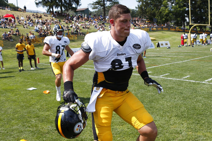 FILE - This Aug. 1, 2019, file photo shows Pittsburgh Steelers tight end Zach Gentry (81) as he performs an agility drill during practice at their NFL football training camp in Latrobe, Pa. Gentry figured he'd be an NFL quarterback, not a tight end. Justin Layne began his college career as a wide receiver, not a cornerback. Sutton Smith is learning how to play linebacker and fullback. All three offer proof of Pittsburgh's emphasis in finding adaptable young players who can do a little bit of everything. (AP Photo/Keith Srakocic, File)