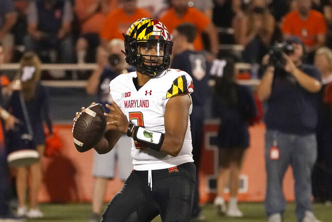 Maryland quarterback Taulia Tagovailoa looks to pass during the first half of an NCAA college football game against Illinois, Friday, Sept. 17, 2021, in Champaign, Ill. (AP Photo/Charles Rex Arbogast)