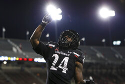 Cincinnati running back Jerome Ford celebrates his touchdown during the first half of the team's NCAA college football game against East Carolina, Friday, Nov. 13, 2020, in Cincinnati. (AP Photo/Aaron Doster)
