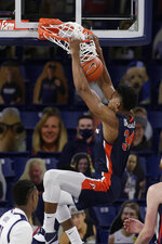 Pepperdine center Victor Ohia Obioha dunks during the first half of the team's NCAA college basketball game against Gonzaga in Spokane, Wash., Thursday, Jan. 14, 2021. (AP Photo/Young Kwak)