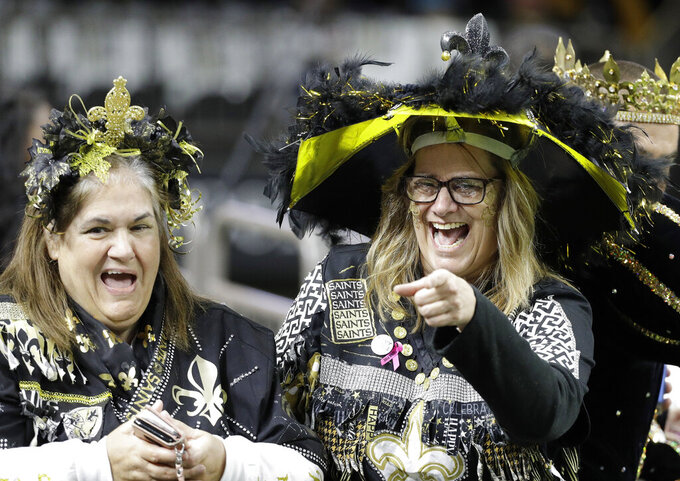 Fans have some fun inside the Mercedes-Benz Superdome before the NFL football NFC championship game between the New Orleans Saints and the Los Angeles Rams Sunday, Jan. 20, 2019, in New Orleans. (AP Photo/David J. Phillip)