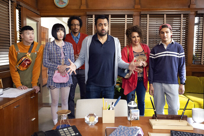 This image released by NBC shows, from left, Joel Kim Booster, Poppy Liu, Samba Schutte, Kal Penn, Diana Marie Riva and Moses Storm in a scene from