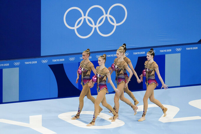 Russian Olympic Committee's rhythmic gymnastics' team performs during the rhythmic gymnastics group all-around final at the 2020 Summer Olympics, Sunday, Aug. 8, 2021, in Tokyo, Japan. (AP Photo/Ashley Landis)