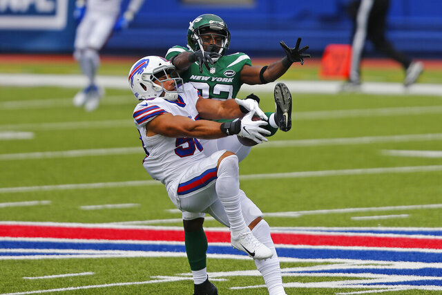 Buffalo Bills outside linebacker Matt Milano (58) intercepts a pass intended for New York Jets wide receiver Jamison Crowder (82) during the first half of an NFL football game in Orchard Park, N.Y., Sunday, Sept. 13, 2020. (AP Photo/Jeffrey T. Barnes)