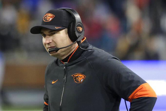 Oregon State coach Jonathan Smith watches from the sideline during the second half of the team's NCAA college football game against Washington State, Saturday, Nov. 23, 2019, in Pullman, Wash. Washington State won 54-53. (AP Photo/Ted S. Warren)