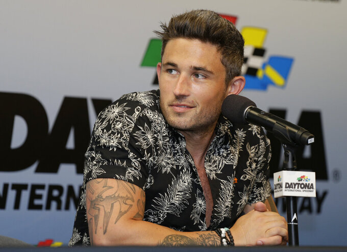 Country music singer Michael Ray makes comments at a news conference before a NASCAR Cup Series auto race at Daytona International Speedway, Saturday, July 6, 2019, in Daytona Beach, Fla. Ray will perform for fans before the race. (AP Photo/Terry Renna)