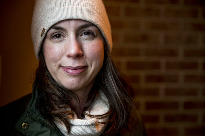Amanda West, 38, a stay at home mother, poses for a photograph following an interview with the Associated Press, Wednesday, Jan. 15, 2020, in Iowa City, Iowa. (AP Photo/Andrew Harnik)