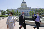 Lt. Gov Spencer Cox, center, joined by his running mate Sen. Deidre Henderson, R-Spanish Fork, arrive for a press conference at the Utah State Capitol Tuesday, July 7, 2020, in Salt Lake City. Jon Huntsman Jr. was narrowly beaten Monday, July 6, 2020, by Cox, who had heightened visibility as he helped respond to the coronavirus and managed to pitch himself as an earnest politician with rural Utah roots. (AP Photo/Rick Bowmer)