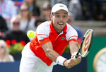 Roberto Bautista Agut, of Spain, returns to Gael Monfils, of France, during the Rogers Cup men's tennis tournament Saturday Aug. 10, 2019, in Montreal.(Paul Chiasson/The Canadian Press via AP)