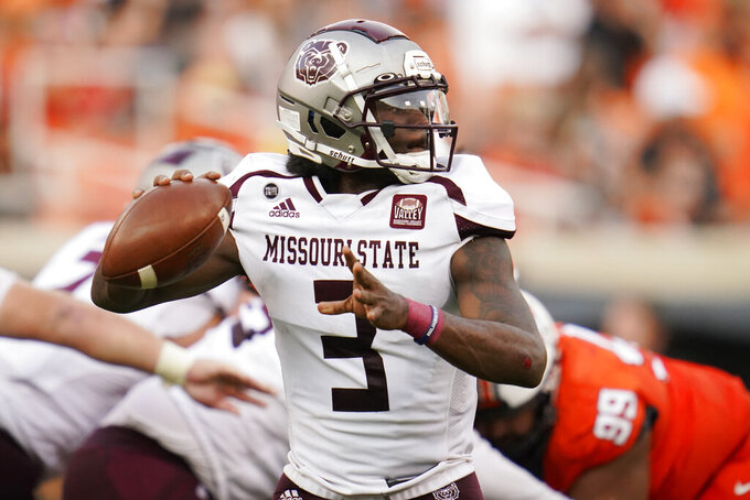 Missouri State quarterback Jason Shelley throws in the first half of an NCAA college football game against Oklahoma State, Saturday, Sept. 4, 2021, in Stillwater, Okla. (AP Photo/Sue Ogrocki)