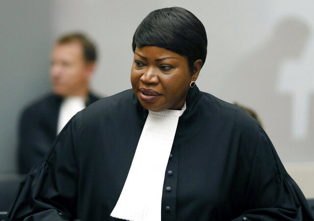"FILE - In this Tuesday Aug. 28, 2018 file photo, Prosecutor Fatou Bensouda at the International Criminal Court (ICC) in The Hague, Netherlands. The International Criminal Court's prosecutor Fatou Bensouda said Friday Dec. 11, 2020, that a preliminary probe found that ""that there is a reasonable basis at this time to believe"" that crimes against humanity and war crimes have been committed in Ukraine meriting a full-scale investigation.  (Bas Czerwinski/Pool file via AP, File)"