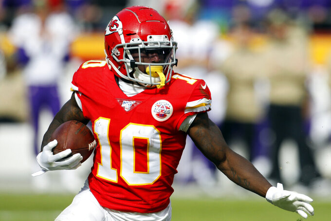 FILE - In this Sunday, Nov. 3, 2019, file photo, Kansas City Chiefs wide receiver Tyreek Hill (10) carries the ball during the first half of an NFL football game against the Minnesota Vikings in Kansas City, Mo. It would be an understatement to the greatest degree to say that Chiefs wide receiver has had an eventful year, one marked by the highest of highs and the lowest of lows. Now, he's hoping to return from a hamstring injury in time to help Kansas City win a fourth consecutive AFC West championship.(AP Photo/Colin E. Braley, File)