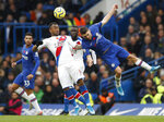 Chelsea's Mateo Kovacic, right, challenges Crystal Palace's Jordan Ayew during their English Premier League soccer match between Chelsea and Crystal Palace at Stamford Bridge stadium in London, Saturday, Nov. 9, 2019. (AP Photo/Alastair Grant)