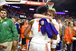 Clemson's John Newman lll, back, celebrates with Wells Hoag after an NCAA college basketball game against Duke Tuesday, Jan. 14, 2020, in Clemson, S.C. Clemson won 79-72. (AP Photo/Richard Shiro)