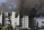 Firemen try to douse a fire at Serum Institute of India, the world's largest vaccine maker that is manufacturing the AstraZeneca/Oxford University vaccine for the coronavirus, in Pune, India, Thursday, Jan. 21, 2021. (AP Photo/Rafiq Maqbool)