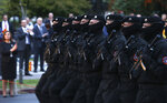Special police unit march during a parade to mark the Independence Day in downtown Skopje, North Macedonia, Wednesday, Sept. 8, 2021. North Macedonia is celebrating Wednesday the 30th anniversary since its independence from former Yugoslavia. (AP Photo/Boris Grdanoski)