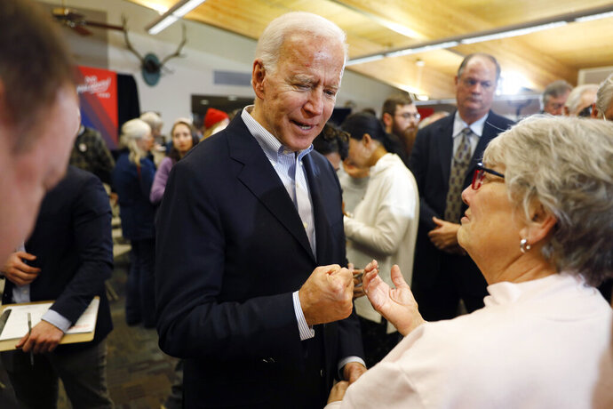 Democratic presidential candidate former Vice President Joe Biden talks with audience members during a bus tour stop at Water's Edge Nature Center, Monday, Dec. 2, 2019, in Algona, Iowa. (AP Photo/Charlie Neibergall)