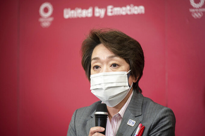 Seiko Hashimoto, president of Tokyo 2020, attends a media huddle following the IOC Executive Board Meeting at the Tokyo 2020 headquarters in Tokyo, Wednesday, April 21, 2021. (Philip Fong/ Pool Photo via AP)