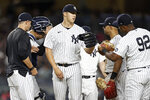 New York Yankees pitcher Jameson Taillon heads to the dugout after being removed the baseball game against the Boston Red Sox during the sixth inning Sunday, July 18, 2021, in New York. (AP Photo/Adam Hunger)