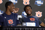Auburn's Horace Spencer, left, and Malik Dunbar laugh during a news conference at the NCAA tournament college basketball tournament Saturday, March 30, 2019, in Kansas City, Mo. Auburn is set to play Kentucky in the Midwest regional final on Sunday. (AP Photo/Jeff Roberson)