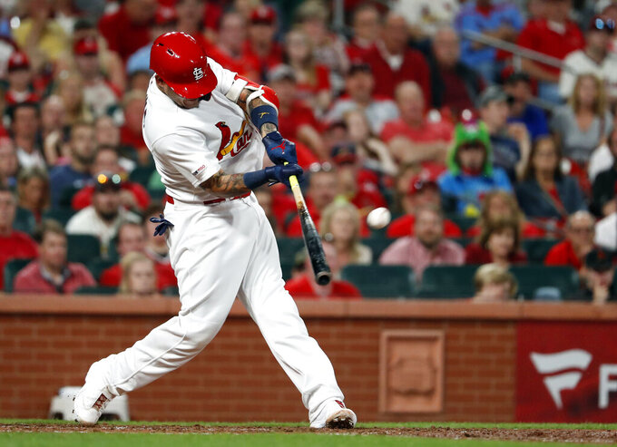 St. Louis Cardinals' Yadier Molina hits a two-run home run during the fourth inning of a baseball game against the Philadelphia Phillies, Monday, May 6, 2019, in St. Louis. (AP Photo/Jeff Roberson)