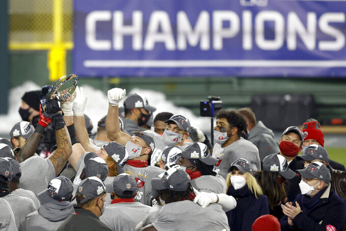 Tampa Bay Buccaneers celebrate after winning the NFC championship NFL football game against the Green Bay Packers in Green Bay, Wis., Sunday, Jan. 24, 2021. The Buccaneers defeated the Packers 31-26 to advance to the Super Bowl. (AP Photo/Jeffrey Phelps)