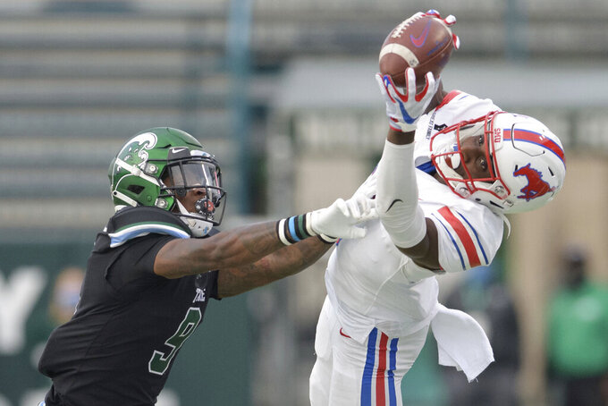 SMU wide receiver Danny Gray, right, makes a catch against Tulane cornerback Jaylon Monroe (9) during an NCAA college football game in New Orleans, Friday, Oct. 16, 2020. (AP Photo/Matthew Hinton)