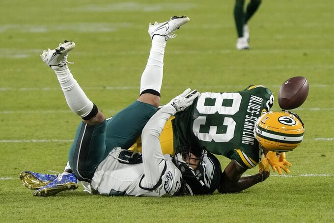 Green Bay Packers' Marquez Valdes-Scantling can't catch a pass with Philadelphia Eagles' Avonte Maddox defending during the second half of an NFL football game Sunday, Dec. 6, 2020, in Green Bay, Wis. (AP Photo/Morry Gash)