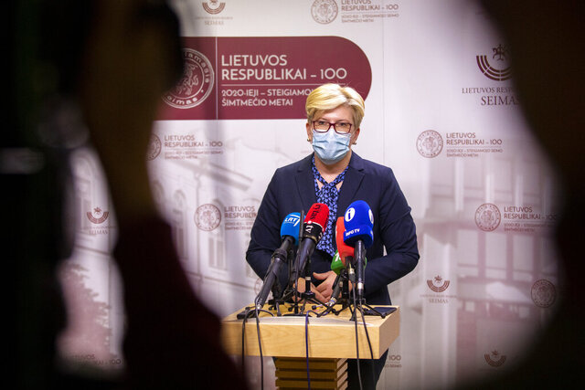 Newly elected prime minister Ingrida Simonyte, speaks to the media, at the Parliament in Vilnius, Lithuania, Tuesday, Nov. 24, 2020. Lithuania's parliament approved Ingrida Simonyte as the new prime minister on Tuesday. (AP Photo/Mindaugas Kulbis)