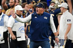 Georgia Tech head coach Geoff Collins yells to his players on the field during the first half of an NCAA college football game against North Carolina Saturday, Sept. 25, 2021, in Atlanta. (AP Photo/John Bazemore)
