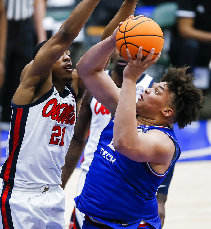 Louisiana Tech forward Kenneth Lofton, Jr. (2) attempts to shoot as Mississippi forward Robert Allen (21) defends during the second half of an NCAA college basketball game in the NIT, Friday, March 19, 2021, in Frisco, Texas. (AP Photo/Brandon Wade)