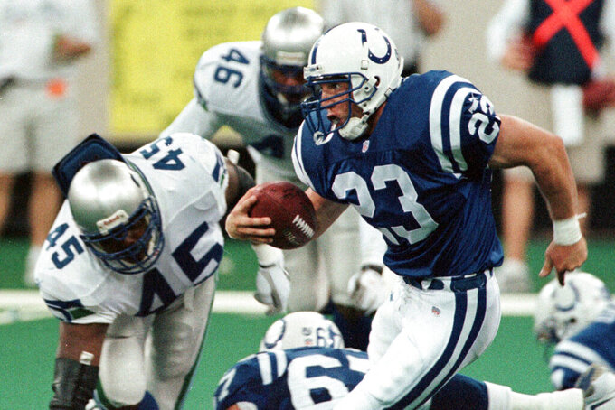 FILE - In this Sept. 2, 1999, file photo, Indianapolis Colts running back Keith Elias (23) runs by Seattle Seahawks' Sedrick Clark (45) and Scott Fields (46) to pick up a first down on the Colts' final drive of an NFL football game in Indianapolis. Elias' dad never played football because he was too small but he influenced the way his son approached the game. Elias spent five seasons in the league as a running back with the Giants and Colts from 1994-99. (AP Photo/John Harrell, File)