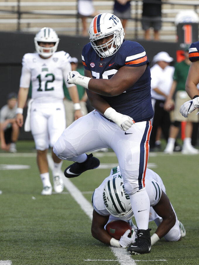 Virginia defensive lineman Jordan Redmond (76) celebrates after stopping Ohio running back Maleek Irons, on the ground, in the first half of an NCAA college football game Saturday, Sept. 15, 2018, in Nashville, Tenn. (AP Photo/Mark Humphrey)