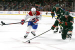 Minnesota Wild's Kevin Fiala (22) tries to gain control of the puck against Montreal Canadiens' Brendan Gallagher (11) in the second period of an NHL hockey game Sunday Oct. 20, 2019, in St. Paul, Minn. (AP Photo/Stacy Bengs)