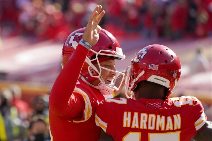 Kansas City Chiefs' Patrick Mahomes, left and wide receiver Mecole Hardman, right, celebrate a touchdown scored by Hardman in the first half of an NFL football game against the New York Jets on Sunday, Nov. 1, 2020, in Kansas City, Mo. (AP Photo/Charlie Riedel)