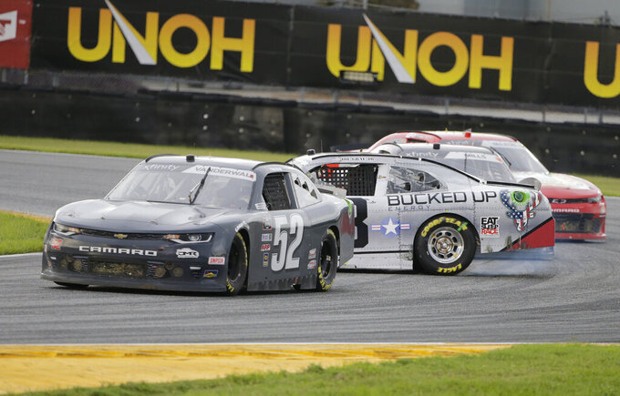 Kody Vanderwal (52) goes by as Joe Graf Jr. (08) spins in the infield during the NASCAR Xfinity series auto race at Daytona International Speedway, Saturday, Aug. 15, 2020, in Daytona Beach, Fla. (AP Photo/Terry Renna)