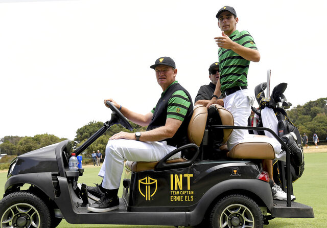 International team captain Ernie Els, left and Joaquin Niemann of Chile during a practice round ahead of the President's Cup Golf tournament in Melbourne, Wednesday, Dec. 11, 2019. (AP Photo / Andy Brownbill)