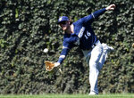 Milwaukee Brewers center fielder Ben Gamel (16) makes a catch on Chicago Cubs' Victor Caratini during the fifth inning of a baseball game, Sunday, Aug. 4, 2019, in Chicago. (AP Photo/David Banks)