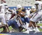 West Virginia running back Alec Sinkfield (20) rushes for a touchdown against Eastern Kentucky during an NCAA college football game on Saturday, Sept. 12, 2020, in Morgantown, W.Va.  (William Wotring/The Dominion-Post via AP)