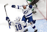Tampa Bay Lightning center Brayden Point (21) celebrates his goal against the Dallas Stars with teammate Ondrej Palat (18) during the second period of Game 3 of the NHL hockey Stanley Cup Final, Wednesday, Sept. 23, 2020, in Edmonton, Alberta. (Jason Franson/The Canadian Press via AP)