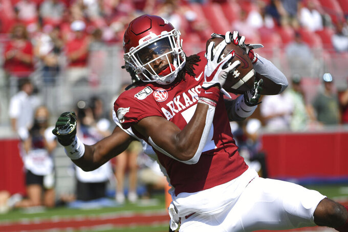 Arkansas receiver Trey Knox makes a touchdown catch in front of a Colorado State defender during the first half of an NCAA college football game, Saturday, Sept. 14, 2019, in Fayetteville, Ark. (AP Photo/Michael Woods)