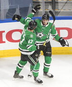 Dallas Stars' Alexander Radulov (47) and Miro Heiskanen (4) celebrate a goal against the Calgary Flames during the first period of a first-round NHL Stanley Cup playoff hockey series in Edmonton, Thursday Aug. 13, 2020. (Jason Franson/The Canadian Press via AP)