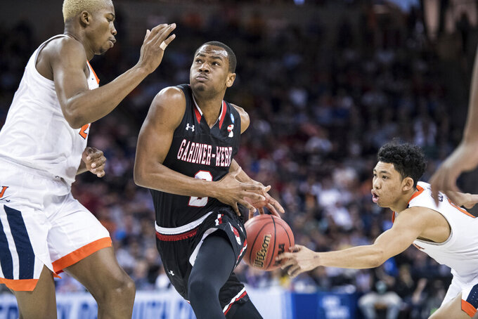 Gardner Webb forward Eric Jamison Jr. (2) has the stripped by Virginia guard Kihei Clark, right, during a first-round game in the NCAA men's college basketball tournament Friday, March 22, 2019, in Columbia, S.C. Virginia defeated Gardner-Webb 71-56. (AP Photo/Sean Rayford)