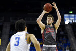 Utah forward Riley Battin, right, shoots in front of UCLA guard Jules Bernard during the second half of an NCAA college basketball game in Los Angeles, Sunday, Feb. 2, 2020. (AP Photo/Kelvin Kuo)