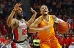 Tennessee guard Lamonte Turner (1) dribbles past Mississippi guard D.C. Davis (20) during the first half of an NCAA college basketball game in Oxford, Miss., Wednesday, Feb. 27, 2019. Tennessee won 73-71. (AP Photo/Rogelio V. Solis)